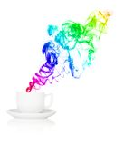 Teacup with colorful smoke in front of white background Royalty Free Stock Photos