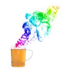 Teacup with colorful smoke in front of white background Royalty Free Stock Photo