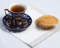 Teacup e biscotti Fotografie Stock