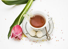 Teacup and flowers Stock Photos