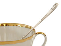 Teacup fragment. Teacup with teaspoon fragment at the white background Stock Photography