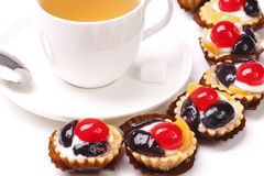 Teacup and fruit cake with biscuit. Jasmine tea and fruit jelly cake with biscuit Royalty Free Stock Images