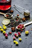 Teacup and herbs on dark stone background Stock Images