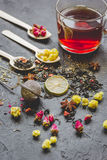 Teacup and herbs on dark stone background Royalty Free Stock Photo