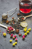 Teacup and herbs on dark stone background Stock Photo