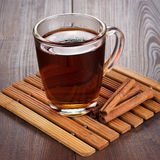 Teacup with hot tea and cinnamon sticks Royalty Free Stock Photography