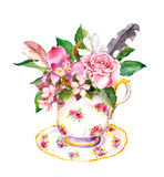 Teacup - leaves, rose flowers, vintage feathers. Watercolor Stock Photo