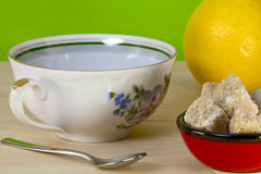 Teacup, lemon and brown sugar Stock Images