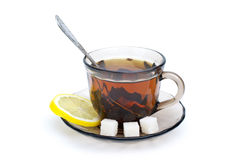 Teacup, lemon slice and some sugar pieces Royalty Free Stock Images