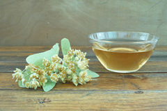 Teacup. With linden tea and linden flowers around royalty free stock photo