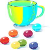 Teacup and multicolored candy Royalty Free Stock Photo