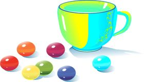 Teacup and multicolored candy Royalty Free Stock Photos