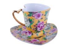 Teacup och Saucer Arkivfoto