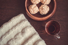 Teacup and rice crispy balls Royalty Free Stock Image