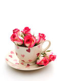 Teacup with roses. Pretty heart patterned teacup with pink roses royalty free stock photography