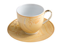Teacup and saucer. Beige teacup and saucer over white background Stock Photo