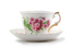 Teacup and Saucer. Antique teacup and saucer on white background Royalty Free Stock Images