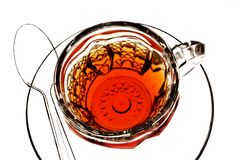 Teacup, Saucer und Löffel Stockfotos