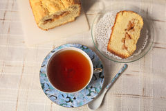 Teacup with slice of  cake. Teacup with slice of a delicious cake on a table Stock Image