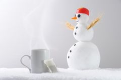 Teacup snowman Royalty Free Stock Images