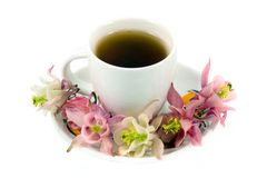 teacup with tea and flowers Stock Photo