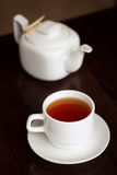 Teacup and teapot. Tea time - white teacup and teapot on black background Stock Photography