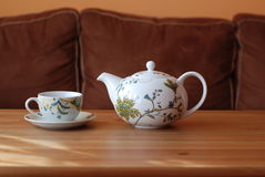 Teacup and teapot Stock Images