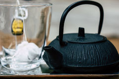 Teacup and teapot on a table in cafe Stock Photography