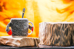 Teacup wearing sweater on wood Royalty Free Stock Photos