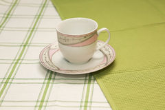 Teacup on white cloth Royalty Free Stock Photo