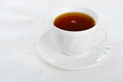 Teacup on white napkin. Stock Photos