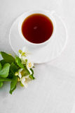 Teacup on white napkin. Stock Photo