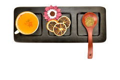 Teacup wooden spoon with tea in tray isolated Royalty Free Stock Photo