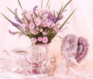 Teacups, ballet dancer statuette, frame Royalty Free Stock Images