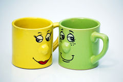 Teacups with faces stock photos