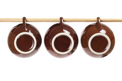Teacups Hanging on Stick Stock Image
