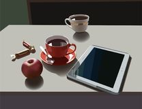 Teacups and tablet Royalty Free Stock Photo