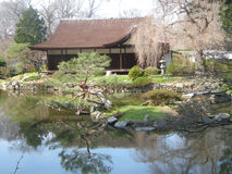 Teahouse. An Authentic Japanese Teahouse.  Surrounded by Dogwood and Cherry Trees as well as other Japanese plants, the pond features Koi as well.  The House and Stock Photos