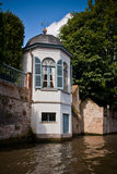 Teahouse at the water. Medieval house on the canals of Bruges Stock Photography