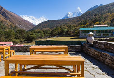 Teahouse wooden tables, Deboche village, Nepal. Stock Photo