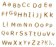 Teak alphabet. Alphabet from teak veneer, letters and signs Stock Images