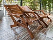 Teak bed chair. Teak bed chair in the patio of the modern house Stock Photography