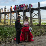 Teak bridge and newly-weds Royalty Free Stock Photography