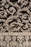 Teak Carve. Ancient teak carve on the temple door at Wat Don Sak, Uttaradit, Thailand Royalty Free Stock Photos