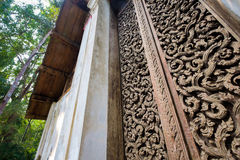 Teak Carve Door. Ancient teak carve on the temple door at Wat Don Sak, Uttaradit, Thailand Stock Photos