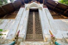 Teak Carve Door. Ancient teak carve on the temple door at Wat Don Sak, Uttaradit, Thailand Royalty Free Stock Photos