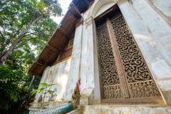 Teak Carve Door. Ancient teak carve on the temple door at Wat Don Sak, Uttaradit, Thailand Stock Photo