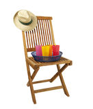 Teak deck chair with hat and drinks royalty free stock photography
