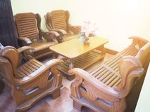 Teak furniture set at room corner. Set of brown chairs and table at vintage room style Royalty Free Stock Photo