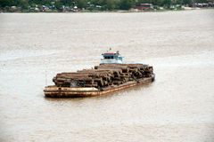 Teak logs in timber on boat in Ayeyarwady river,Myanmar. Stock Images